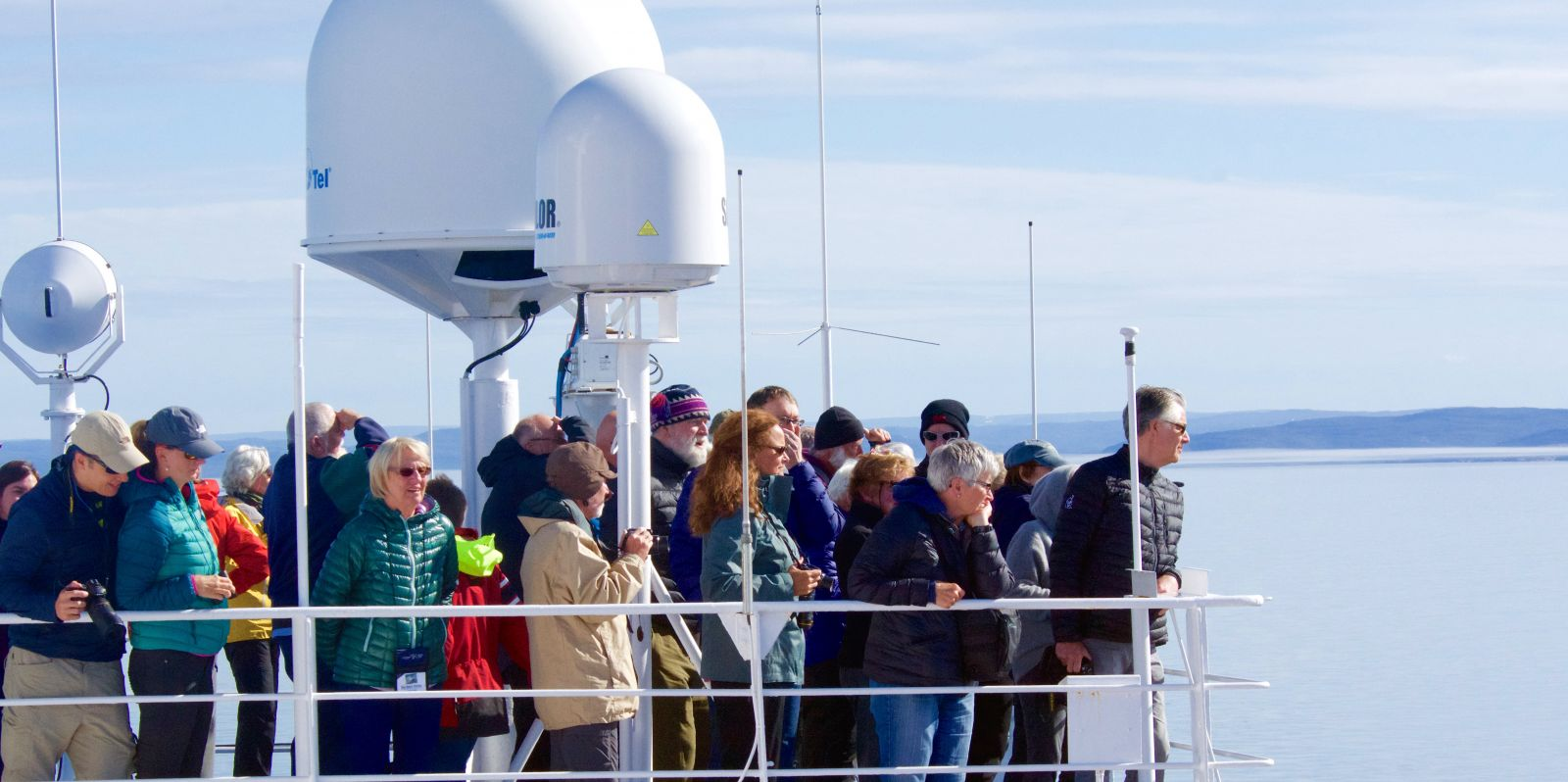 adventure-canada-guests-looking-out-on-deck